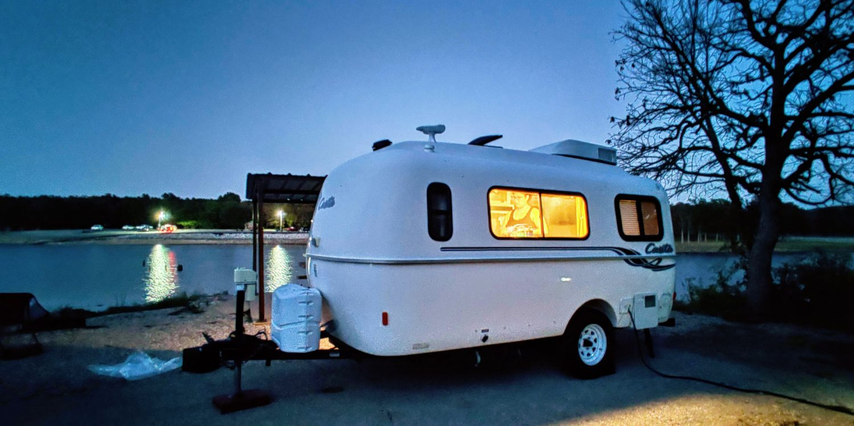 Casita travel trailer at night by Oklahoma's Skiatook Lake
