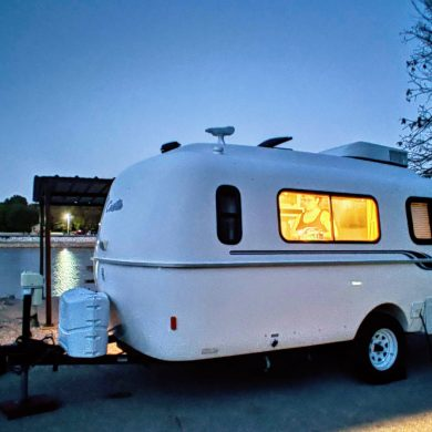 Casita travel trailer at night by Oklahoma's Skiatook Lake
