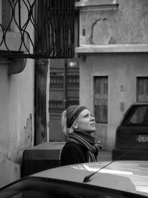 Girl staring up on Bucharest, staring up