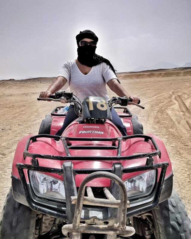 Kelsey on an ATV in the desert outside Hurghada