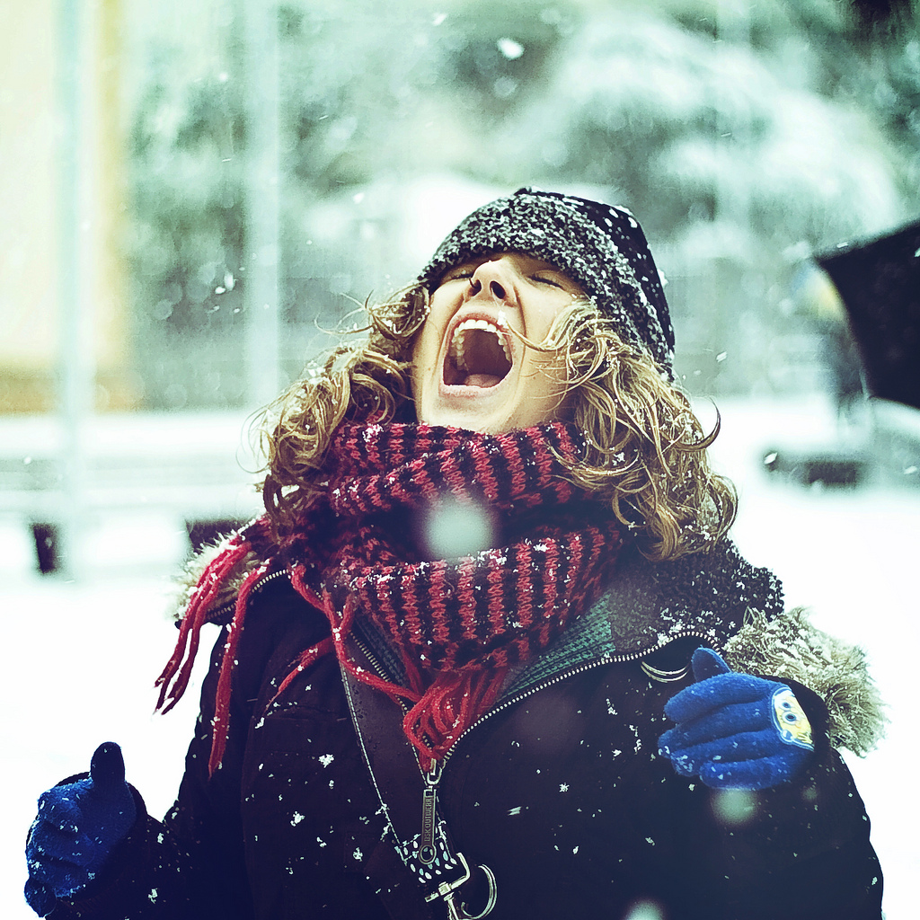 Woman catching snowflakes in her mouth in Catalonia, Spain