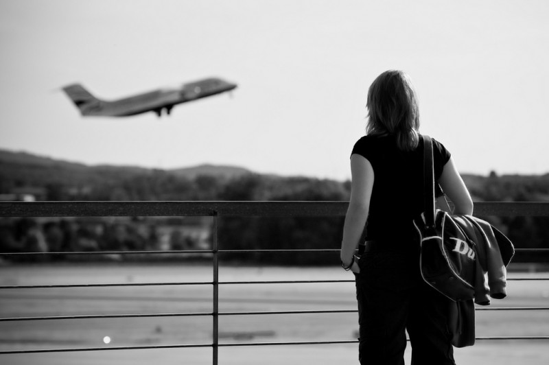Girl Watching Airplane Take Off in Zurich