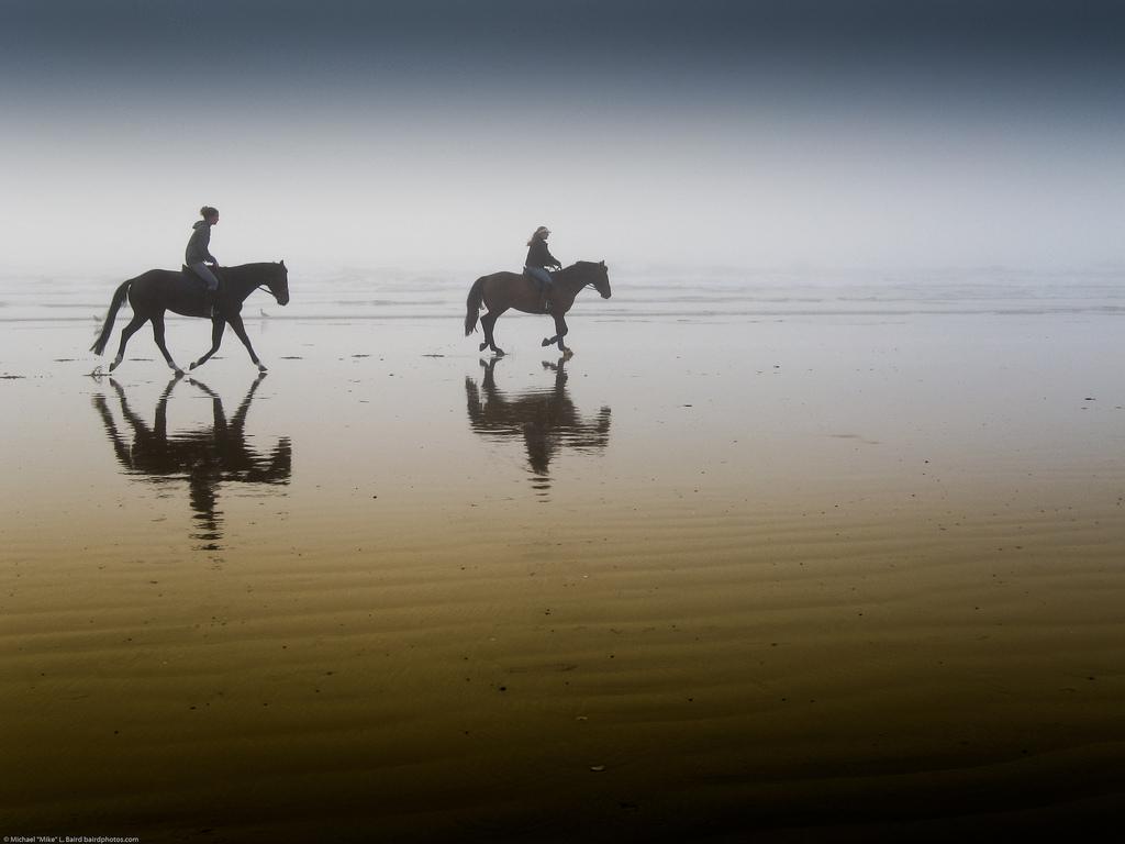 2 Girls Riding Horseback at Morro Strand State Beach, California
