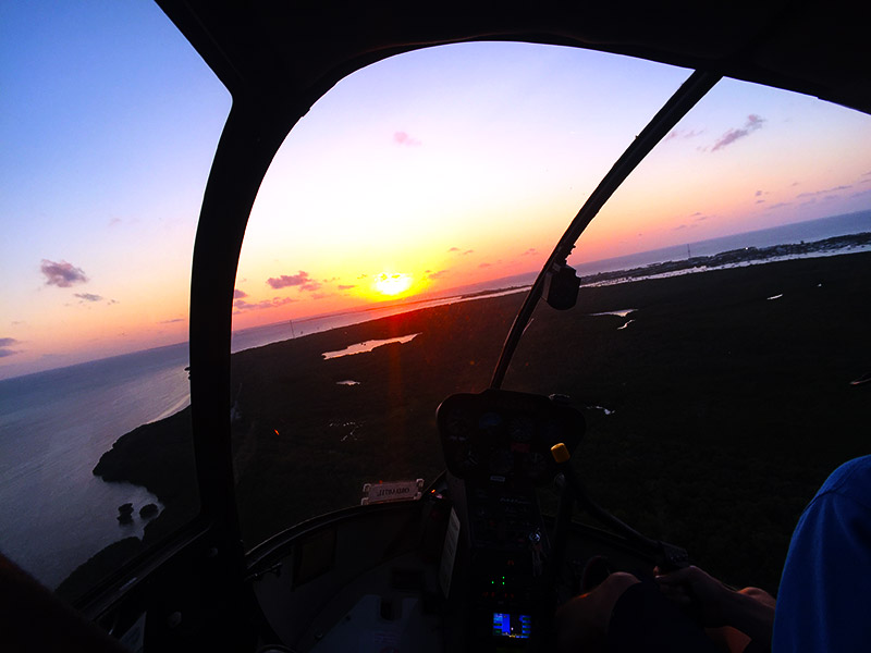 View from the helicopter cockpit at sunset