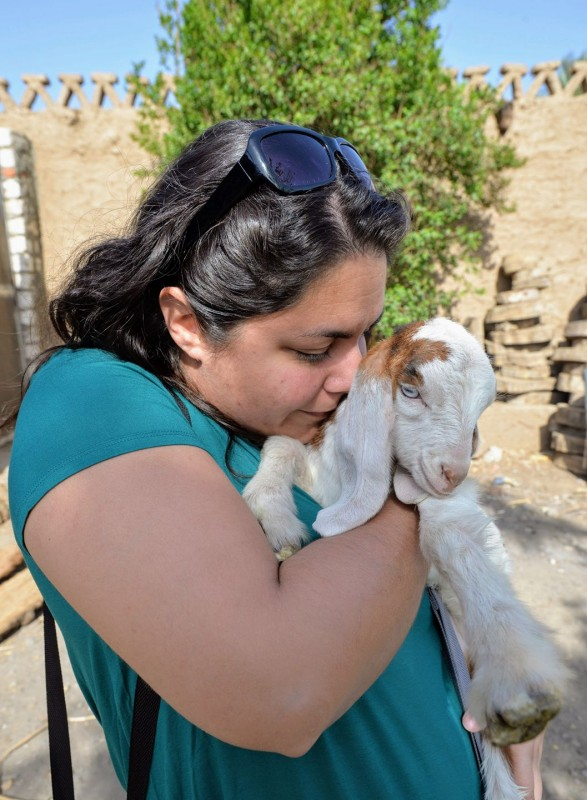 Kelsey Kissing a Baby Goat in Egypt