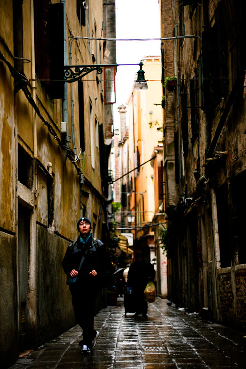 Solo traveler walking streets of Venice, Italy
