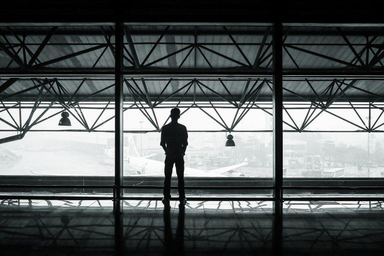Man in Airport Window