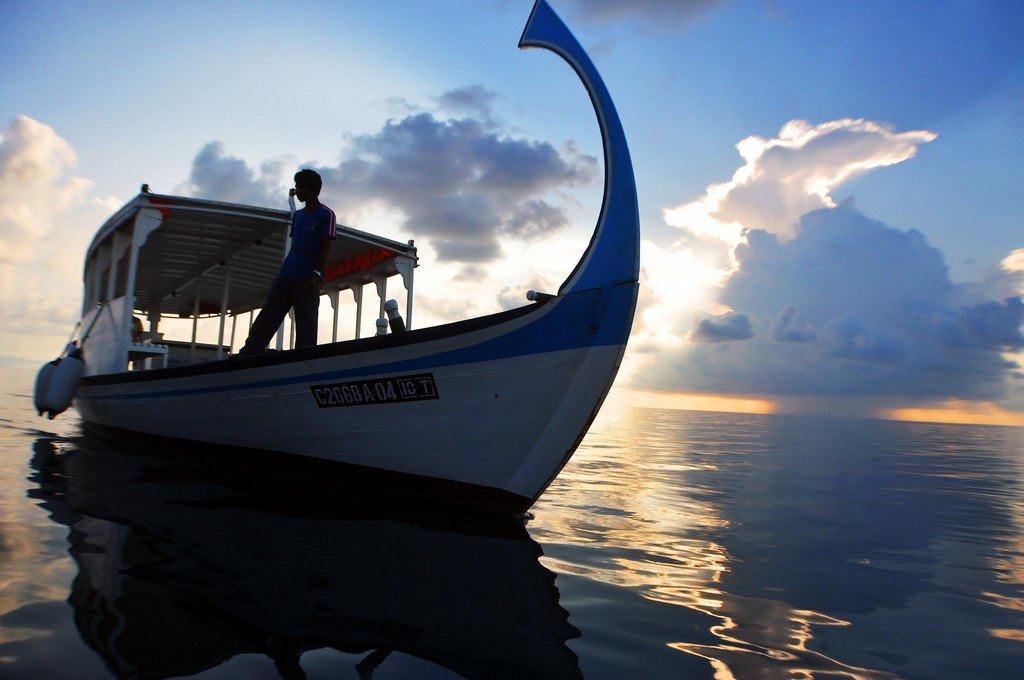 Man on a boat, Maldives