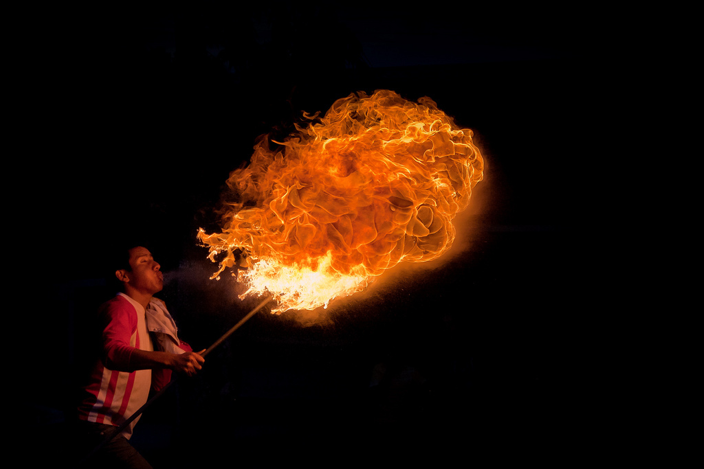 Man blowing fire in Quito, Ecuador