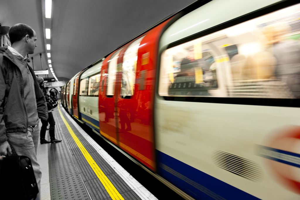 Man waiting for subway in the London Underground