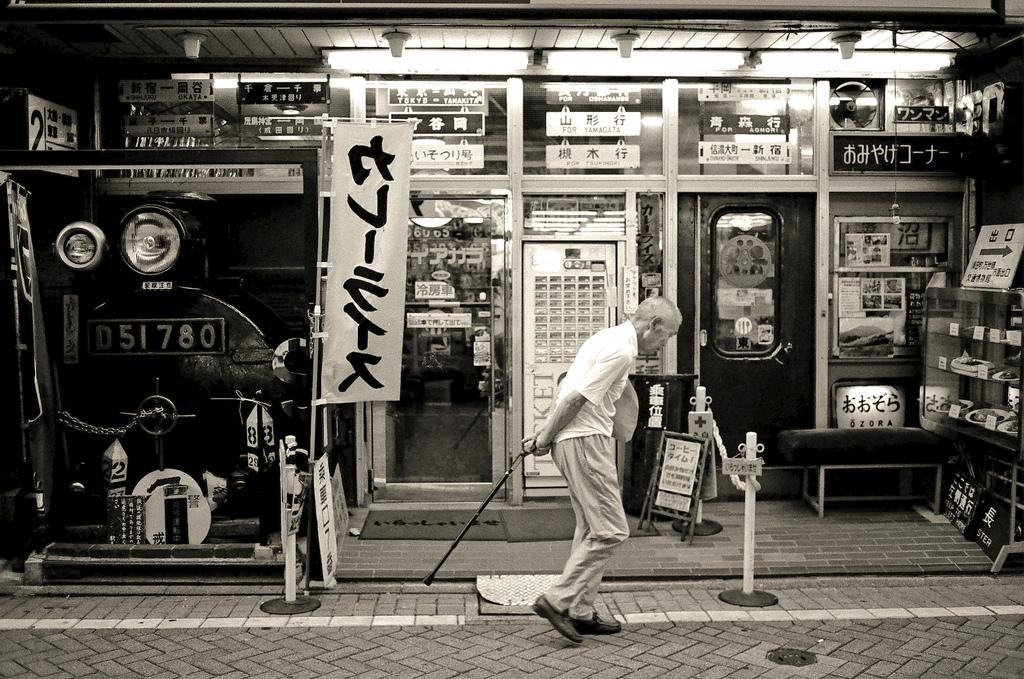 Old man walking street in Tokyo, Japan (black and white)