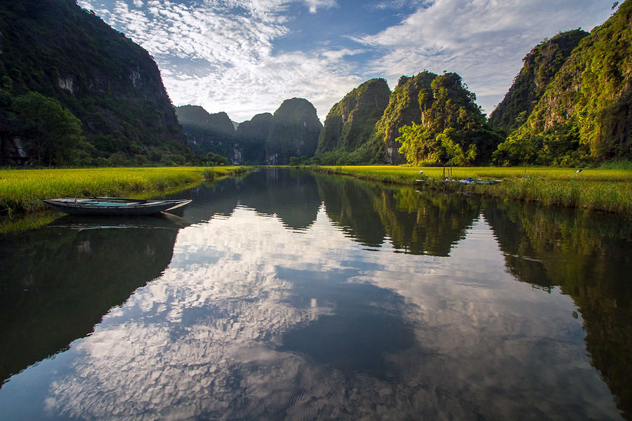 Boat on still water in the Tam Coc Rice Valley, Vietnam