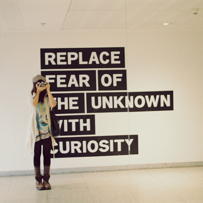 "Sign: ""Replace fear of the unknown with curiosity."""