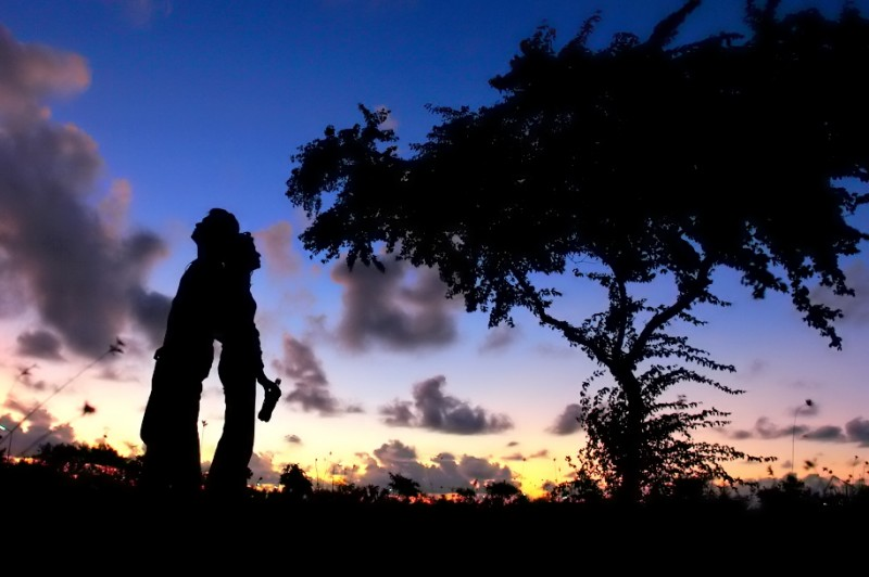 Silhouette of a Couple Standing Together