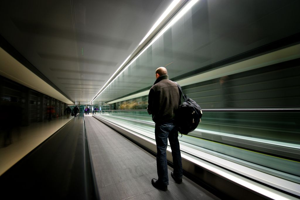 Man on moving walkway at Dublin Airport
