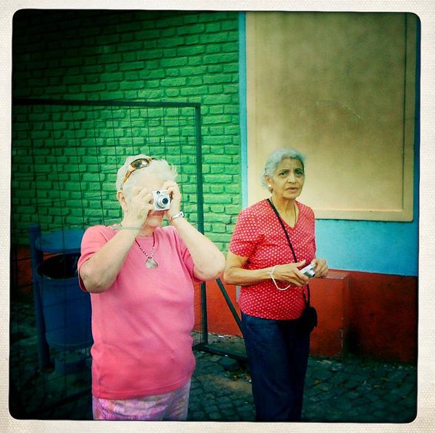 Two Ladies Taking iPhone Photos