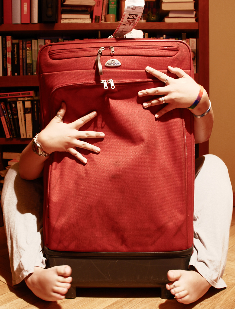 Woman Embracing Red Suitcase